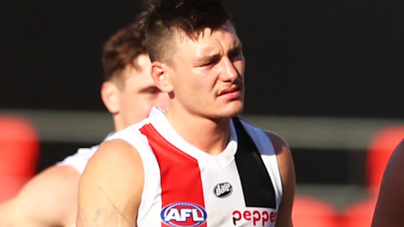 St Kilda players are pictured looking dejected as they leave the field after the loss to Fremantle.