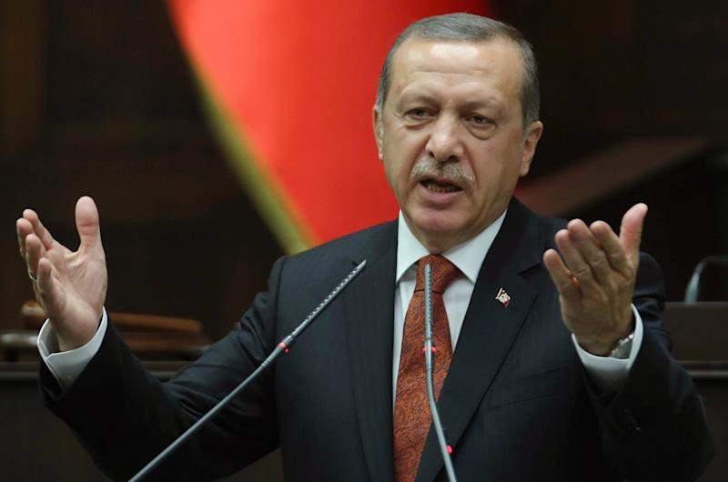 Turkish Prime Minister Recep Tayyip Erdogan addresses deputies from the ruling Justice and Development Party (AKP) at the parliament in Ankara, on July 15, 2014