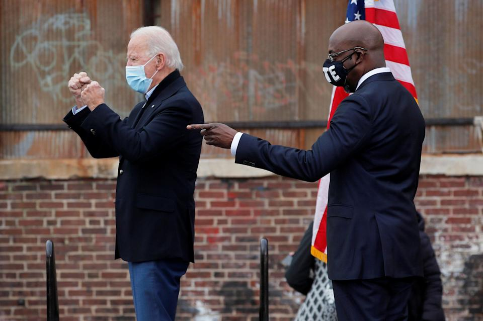 President-elect Joe Biden alongside Democratic Senate candidate Raphael Warnock during a drive-in campaign rally ahead of the Jan. 5 runoff elections, in Atlanta, Dec. 15. (Photo: Mike Segar / Reuters)