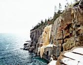 <p>The winter provides even more fun activity opportunities in Acadia National Park. Shown here, hikers go ice climbing on a frozen waterfall created by the cold weather, dangling right over the Atlantic Ocean. </p>