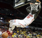 New Mexico's Caleb Martin dunks during the second half of the team's NCAA college basketball game against Wyoming in the Mountain West Conference men's tournament Wednesday, March 13, 2019, in Las Vegas. (AP Photo/Isaac Brekken)