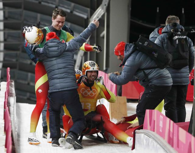 Luge - Pyeongchang 2018 Winter Olympic Games - Team Relay - Pyeongchang, South Korea - February 15, 2018 - Tobias Wendl and Tobias Arlt of Germany react after finishing. REUTERS/Edgar Su