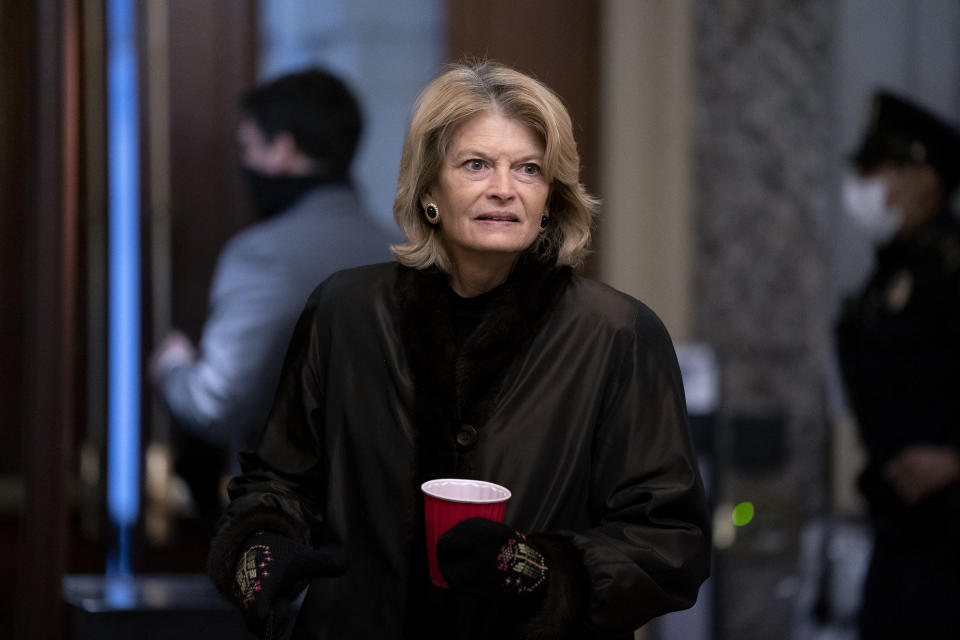 FILE - In this Feb. 13, 2021, file photo, U.S. Sen. Lisa Murkowski, R-Alaska, arrives at the start of the fifth day of the second impeachment trial of former President Trump at the Capitol in Washington. The Alaska Republican Party has not only censured Murkowski for voting to convict former President Donald Trump in his impeachment trial, but it also does not want her to identity as a GOP candidate in next year's election, a member of the party's State Central Committee said Tuesday, March 16, 2021. (Stefani Reynolds/Pool Photo via AP, File)