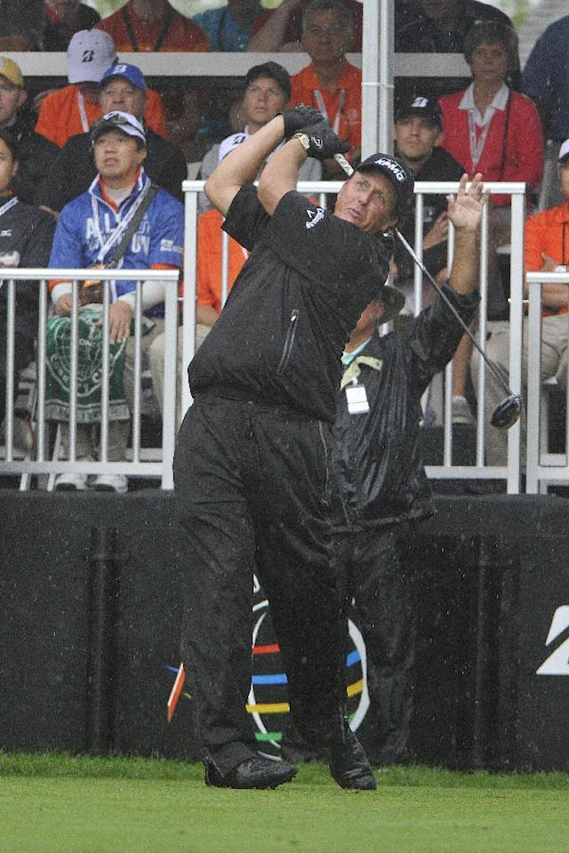 Phil Mickelson tees off on the first hole of the final round of the Bridgestone Invitational golf tournament, Sunday, Aug. 3, 2014, in Akron, Ohio. (AP Photo/Phil Long)