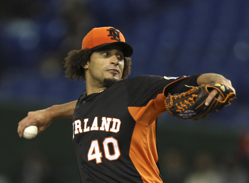 Netherlands' starter Orlando Yntema delivers a pitch against Cuba in the first inning of their World Baseball Classic second round game at Tokyo Dome in Tokyo, Monday, March 11, 2013. (AP Photo/Toru Takahashi)