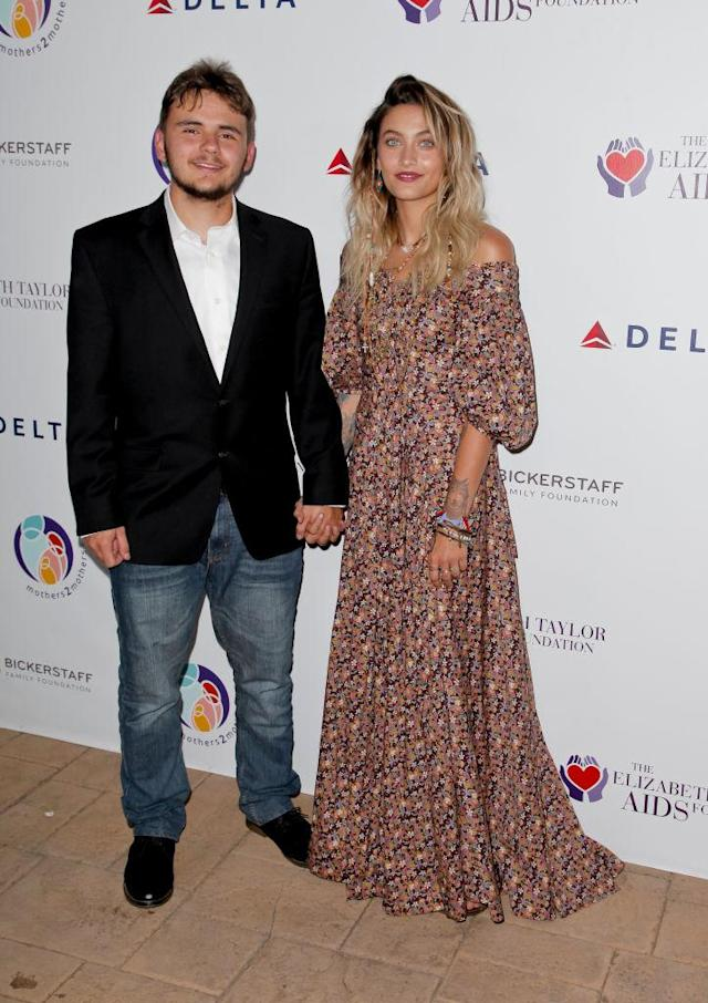 Paris Jackson's off-the-shoulder frock complimented her layered blonde locks and dark lip on the red carpet with her brother Prince at the Elizabeth Taylor AIDS Foundation and mothers2mothers dinner in Beverly Hills on Oct. 24, 2017. (Photo: Getty)