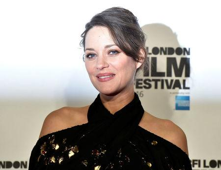 "Marion Cotillard poses as she arrives for the gala screening of the film ""Its only the end of the world"" , during the 60th British Film Institute London Film Festival at Leicester Square in London"