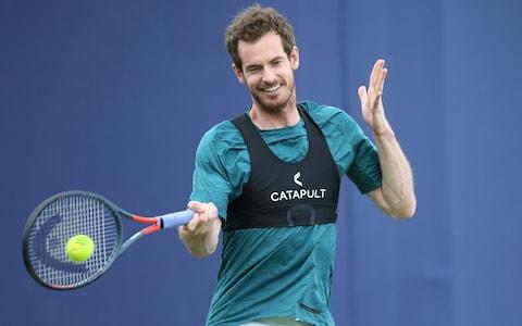 <span>Murray practising at Queen's on Friday</span> <span>Credit: Getty Images </span>