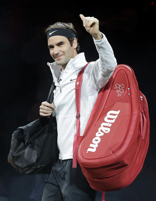 Roger Federer, of Switzerland, waves as he walks onto the court before playing in an exhibition tennis match with partner Bill Gates against Jack Sock and Savannah Guthrie in San Jose, Calif., Monday, March 5, 2018. (AP Photo/Jeff Chiu)