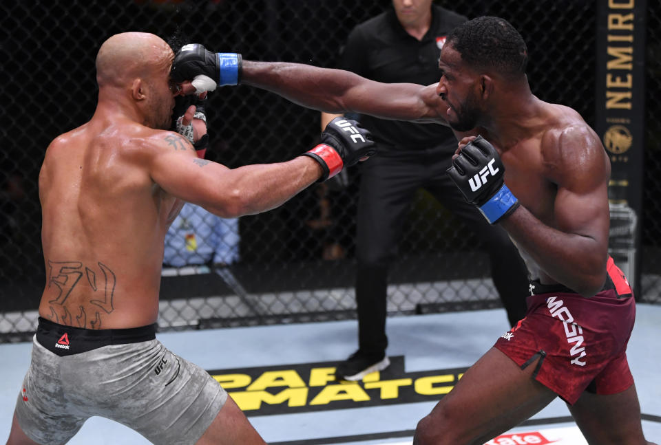 LAS VEGAS, NEVADA - AUGUST 29: In this handout image provided by UFC, (R-L) Neil Magny punches Robbie Lawler in their welterweight fight during the UFC Fight Night event at UFC APEX on August 29, 2020 in Las Vegas, Nevada. (Photo by Jeff Bottari/Zuffa LLC via Getty Images)