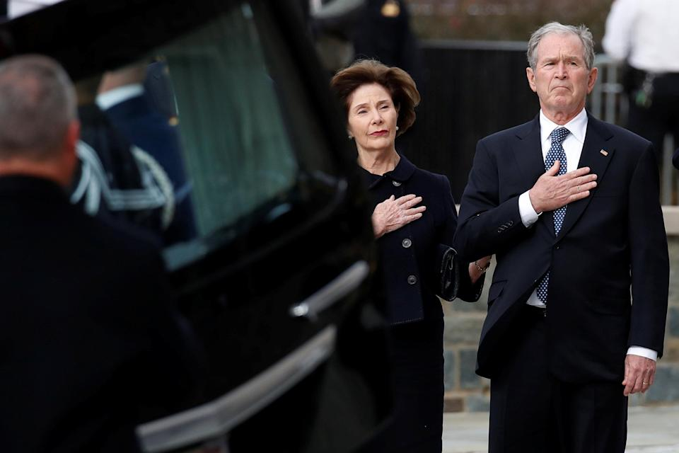 Former President George W. Bush and Laura Bush watch as the flag-draped casket of former President George H.W. Bush is carried by a joint services military honor guard to a State Funeral at the National Cathedral, Wednesday, Dec. 5, 2018, in Washington. (Photo: Alex Brandon/Pool via Reuters)