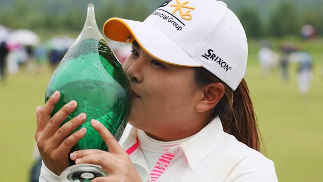 Inbee Park kisses the trophy after winning the Manulife Financial LPGA Classic golf tournament Sunday, June 8, 2014 in Waterloo, Ontario. (AP Photo/The Canadian Press, Dave Chidley)