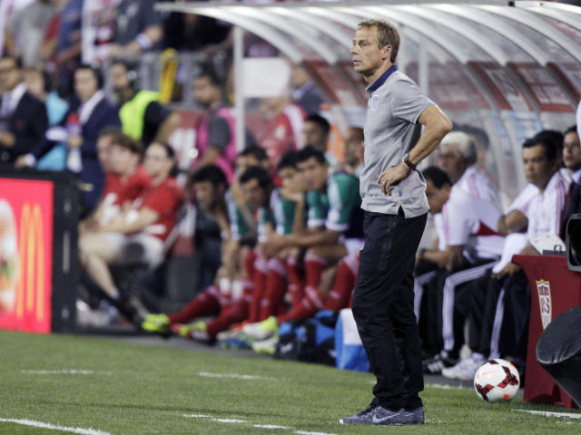 In this photo taken Tuesday, Sept. 10, 2013, United States manager Jurgen Klinsmann watches from the sideline during a World Cup qualifying soccer match against Mexico in Columbus, Ohio. The United States clinched its seventh straight World Cup appearance, getting second-half goals from Eddie Johnson and Landon Donovan on Tuesday night in a 2-0 win over Mexico. (AP Photo/Jay LaPrete)