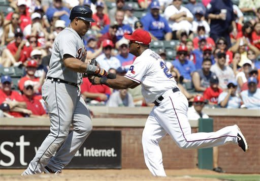 Detroit Tigers Miguel Cabrera, left, is tagged out out on the force play by Texas Rangers third baseman Adrian Beltre (29) during the fourth inning of a baseball game Sunday, Aug. 12, 2012, in Arlington, Texas. (AP Photo/LM Otero)