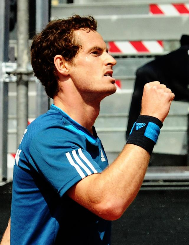 Britain's Andy Murray clinches his fist after winning a point to Italy's Fabio Fognini during a Davis Cup World Group quarterfinal match in Naples, Italy, Sunday, April 6, 2014. (AP Photo/Salvatore Laporta)