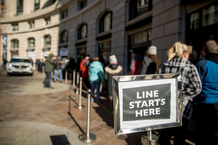 Furloughed workers wait in line Tuesday to receive food and supplies from World Central Kitchen, the nonprofit organization started by chef Jose Andres in Washington. (Photo: Andrew Harnik/AP)