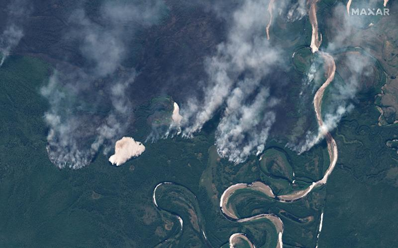 Smoke rises from wildfires near Berezovka River in the Russian republic of Altai, western Siberia, in this June 23, 2020 - Maxar Technologies via REUTERS