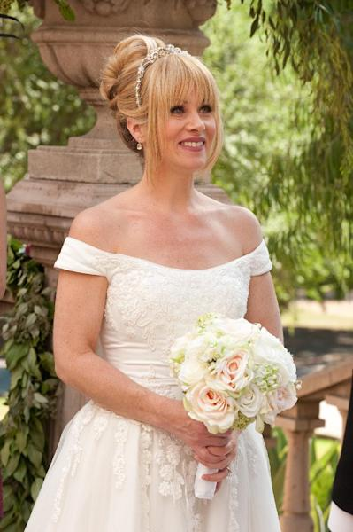 """This undated publicity photo released by NBC shows Christina Applegate, as Reagan Brinkley, in the TV series, """"Up All Night,"""" Season 2, """"The Wedding,"""" Episode 211. Applegate says she's bowing out of NBC's """"Up All Night."""" In a statement Friday, Feb. 8, 2013, the actress said the show has taken a """"different creative direction"""" and she's decided to move on to other projects. She called the sitcom a great experience and said she will miss her co-workers. (AP Photo/NBC, Colleen Hayes)"""