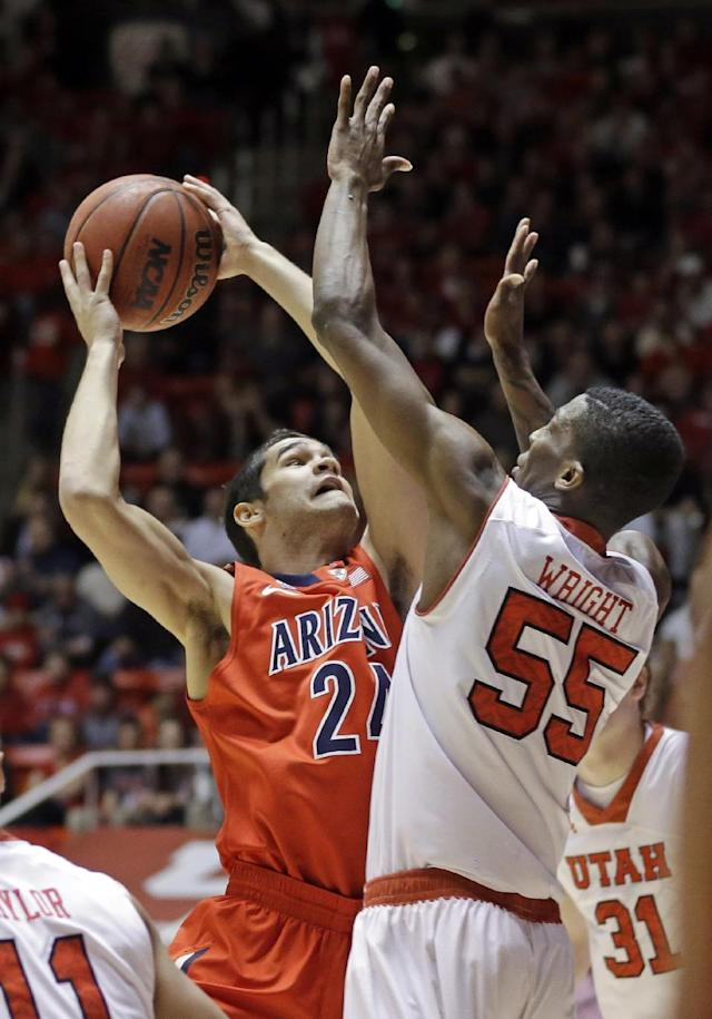 Arizona's Elliott Pitts (24) shoots as Utah's Delon Wright (55) defends in the first half of an NCAA college basketball game, Wednesday, Feb. 19, 2014, in Salt Lake City. (AP Photo/Rick Bowmer)