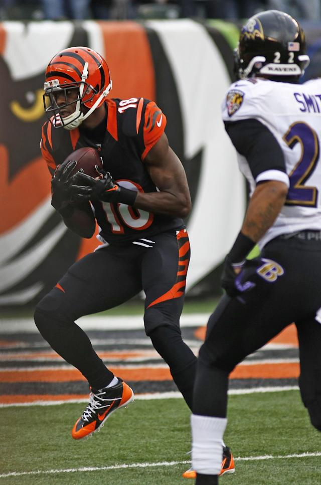 Cincinnati Bengals wide receiver A.J. Green (18) catches a 53-yard touchdown pass against Baltimore Ravens cornerback Jimmy Smith in the first half of an NFL football game on Sunday, Dec. 29, 2013, in Cincinnati. (AP Photo/David Kohl)