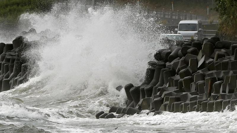 Typhoon unleashes strong winds and rain in southern Japan