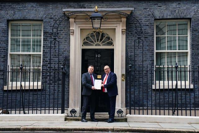 Chairman of the Police Federation John Apter (left) and Ken Marsh, Chairman of the Metropolitan Police Federation deliver a letter to 10 Downing Street, London (Victoria Jones/PA)