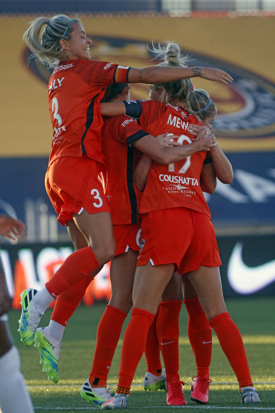 Houston Dash forward Rachel Daly (3) joins teammates celebrating with midfielder Kristie Mewis (19) after Mewis' goal against OL Reign during the first half of an NWSL Challenge Cup soccer match at Zions Bank Stadium, Saturday, July 4, 2020, Herriman, Utah. (AP Photo/Rick Bowmer)