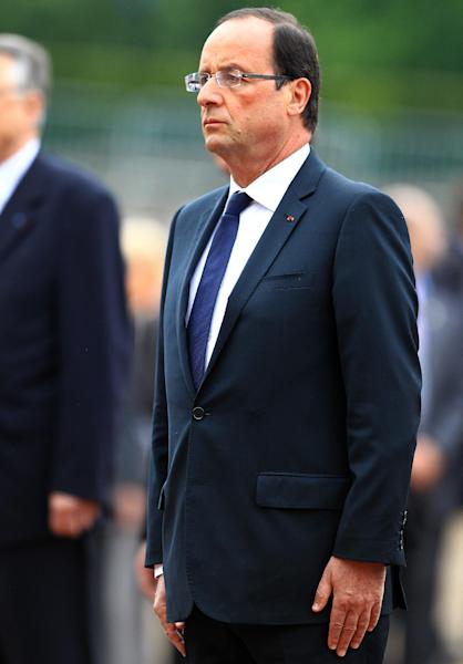 French President Francois Hollande attends a ceremony to mark the 72nd anniversary of Gen. Charles de Gaulle's appeal of June 18, 1940, at the Mont Valerien memorial in Suresnes, outside of Paris, Monday, June 18, 2012. The appeal, which was delivered on the BBC by Charles de Gaulle, served to rally his countrymen after the fall of France to Nazi Germany. (AP Photo/Bob Edme, Pool)