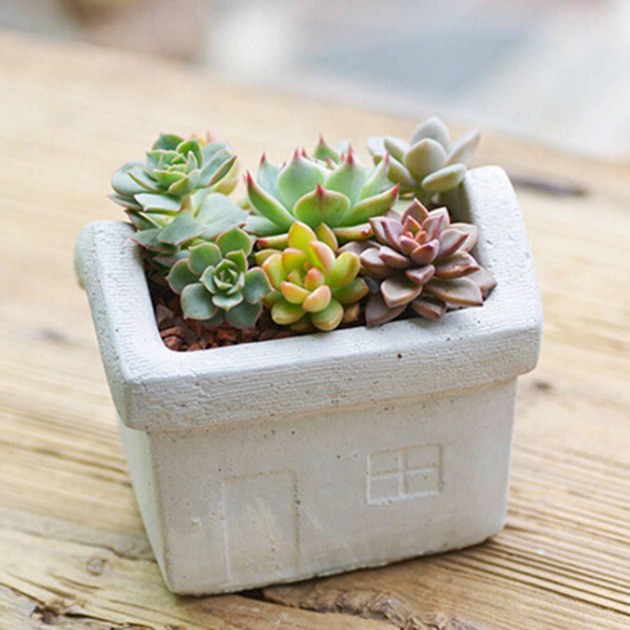 """<p><a rel=""""nofollow noopener"""" href=""""https://www.notonthehighstreet.com/dingadingterrariums/product/concrete-house-planter"""" target=""""_blank"""" data-ylk=""""slk:BUY NOW"""" class=""""link rapid-noclick-resp"""">BUY NOW</a> <strong>Notonthehighstreet.com, £14.50</strong></p><p>Give a sweet gift to friends or family with this house-shaped planter by Dingading Terrariums. As a bonus you can choose to have the planter on its own or with three succulents.</p>"""