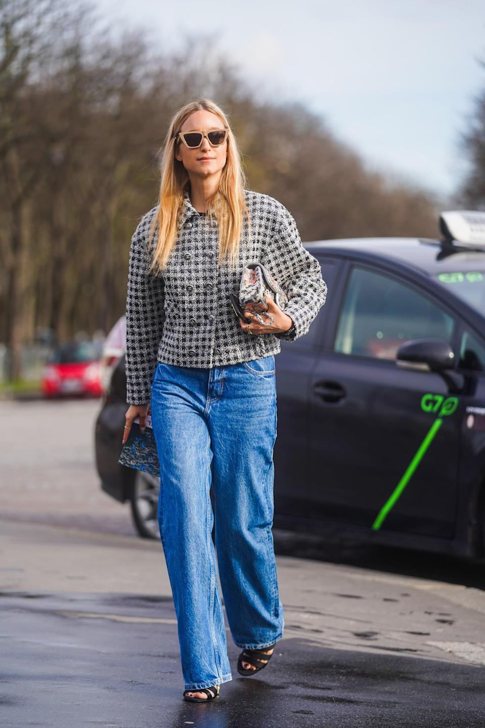 <p>Baggy jeans instantly take the stuffiness out of a classic tweed jacket. </p>