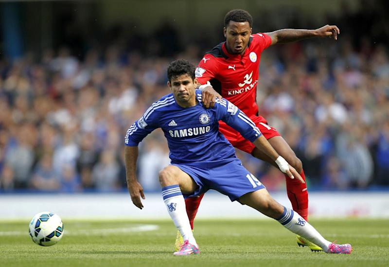 Chelsea's Brazilian-born Spanish striker Diego Costa (L) vies with Leicester City's English defender Liam Moore during the English Premier League football match between Chelsea and Leicester City at Stamford Bridge on August 23, 2014
