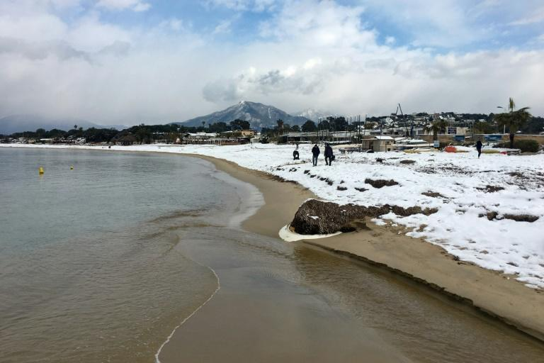 The shore of the bay of Ajaccio covered with snow, on the French Mediteranean island of Corsica