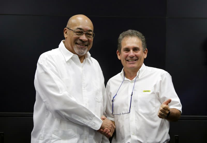 Suriname's President Desi Bouterse and Rudolf Elias, director of Suriname's state-owned oil company Staatsolie, shake hands after a news conference announcing that Apache Corporation and Total made a major oil discovery offshore Suriname, in Paramaribo