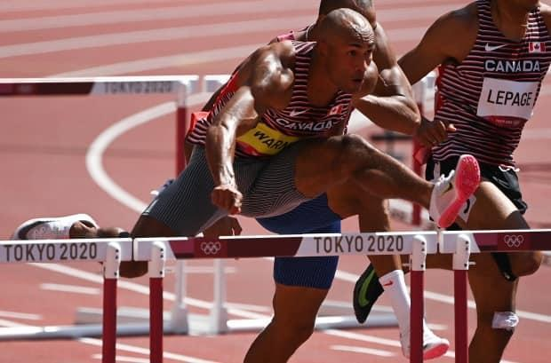Canada's Damian Warner ran to an Olympic best in the men's decathlon 110-metre hurdles on Thursday at the Tokyo Games. (Ina Fassbender/AFP via Getty Images - image credit)