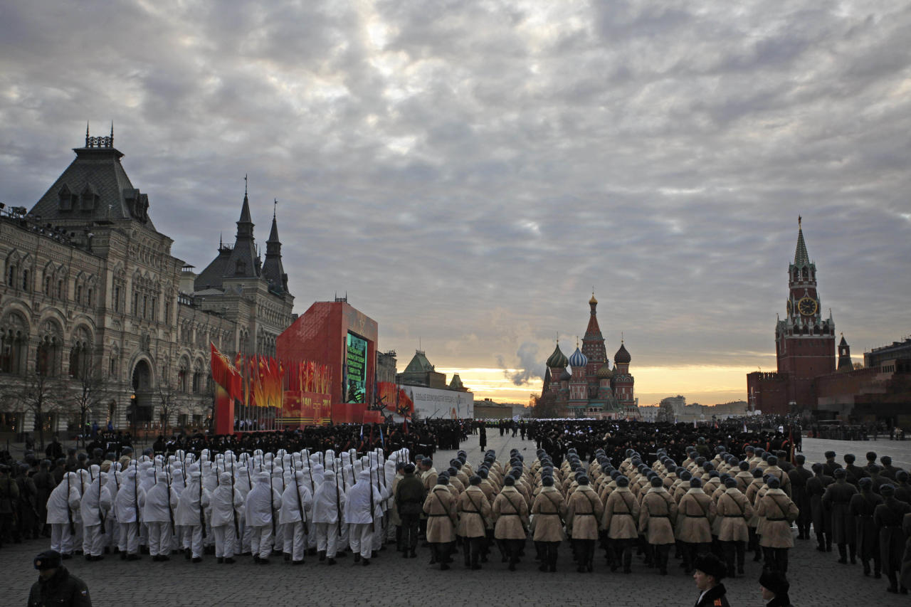 Russian soldiers dressed in Red Army World War II uniform prepare to parade in Red Square in Moscow, Russia, early Monday, Nov. 7, 2011. Thousands of Russian soldiers and military cadets have marched across Red Square to mark the 70th anniversary of a historic World War II parade.The show honored the participants of the Nov. 7 1941 parade who then headed directly to the front to defend Moscow from the Nazi forces. The parade Monday involved about 6,000 people, many of them dressed in World War II-era uniforms. (AP Photo/Alexander Zemlianichenko Jr)