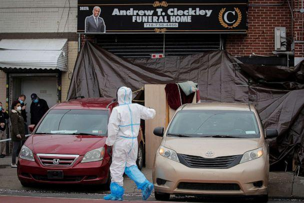 PHOTO: Workers are seen outside the Andrew T. Cleckley Funeral Services funeral home in Brooklyn, N.Y., April 30, 2020. (Brendan Mcdermid/Reuters)