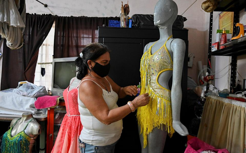 A seamstress perfects a salsa costume in Cali, Colombia - Getty