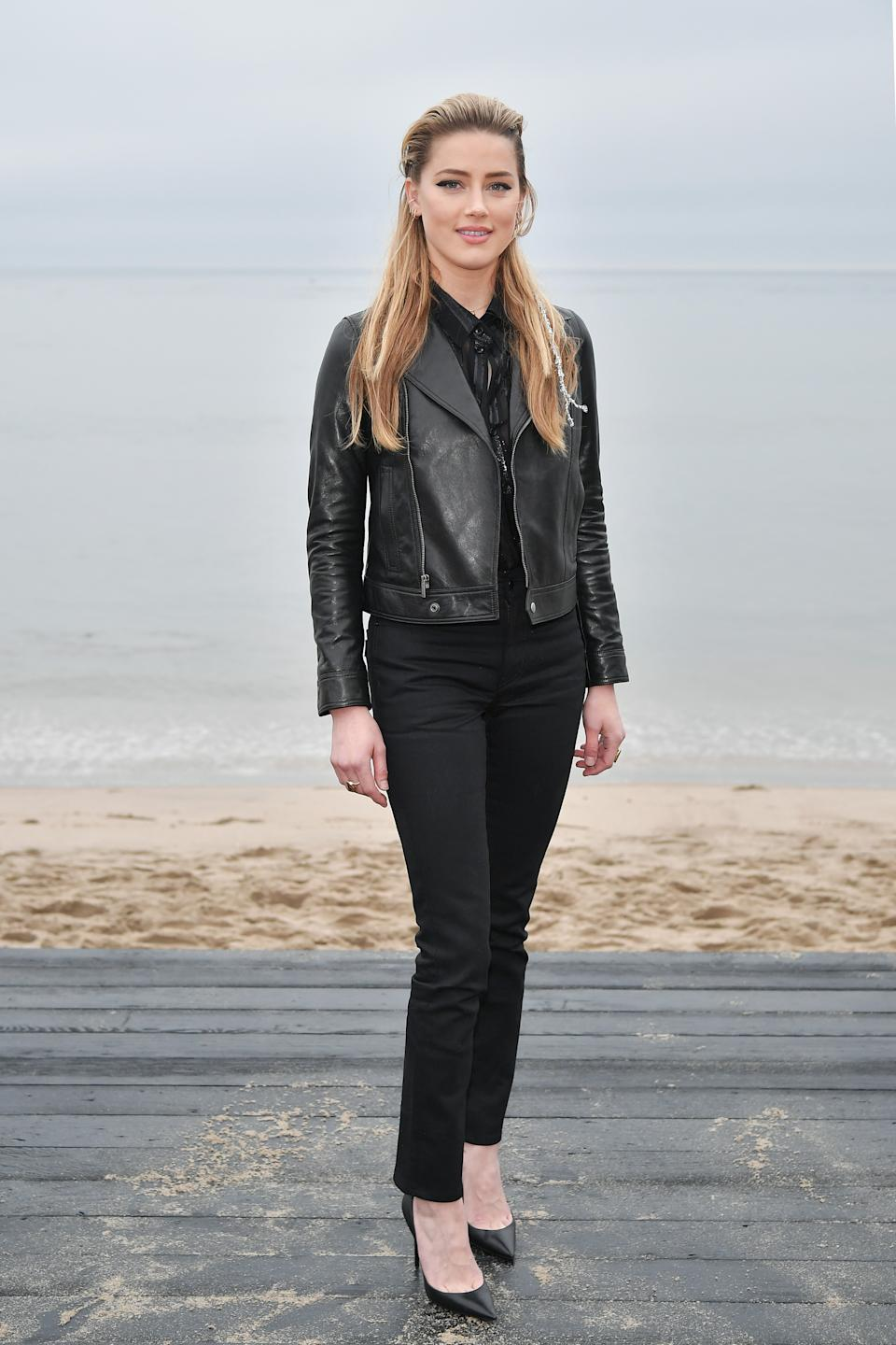 Actress Amber Heard was another A-lister to choose an all-black ensemble for the show wearing a simple leather jacket, shirt and jean combo. <em>[Photo: Getty]</em>