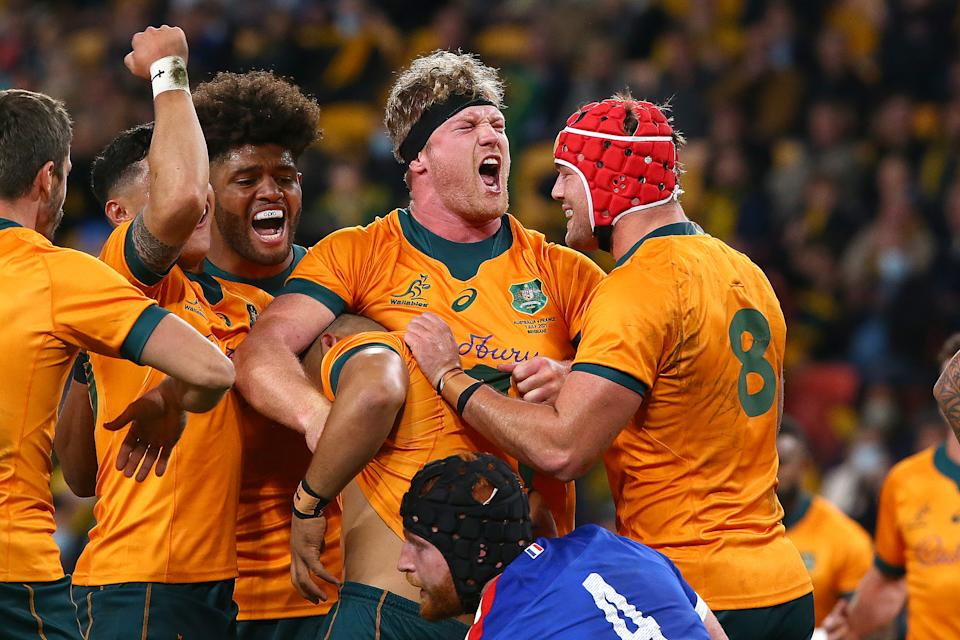 Seen here, Wallabies players celebrate their Test win over France.