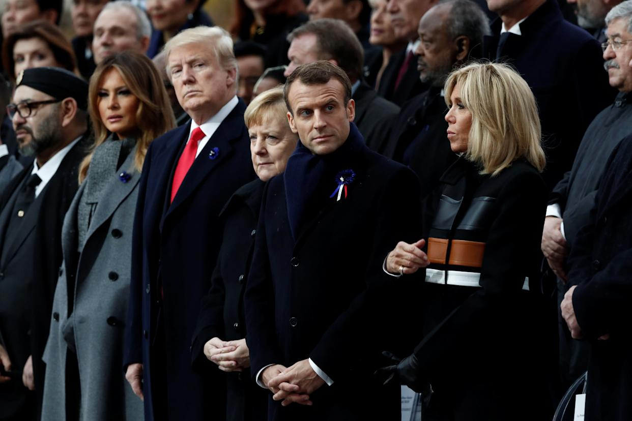 U.S. President Donald Trump and first lady Melania Trump; German Chancellor Angela Merkel; andFrench President Emmanuel Macron and his wife, Brigitte Macron, attend Sunday's commemoration of Armistice Day at the Arc de Triomphe in Paris. (Photo: Reuters)