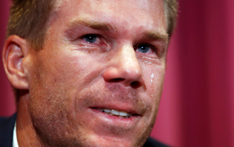 In this March 31, 2018 photo, former Australian cricket vice captain David Warner cries as he talks to the media in Sydney, Saturday, March 31, 2018, after being sent home from South Africa following a ball tampering scandal. Warner and captain Steve Smith were banned for 12 months while young batsman Cameron Bancroft received 9 months after an investigation into the Australian cricket team's cheating scandal identified Warner as the instigator of the ball tampering plan that unraveled in South Africa. (AP Photo/Daniel Munoz, File)