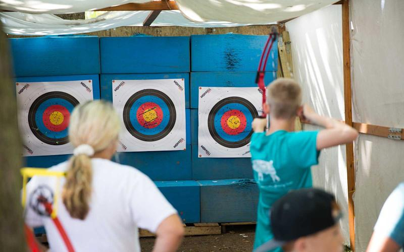 The fair grounds offer a wide range of activities for young and old. As part of the Iowa Department of Natural Resources building, children can practice their archery skills in a makeshift range. | Jason Bergman