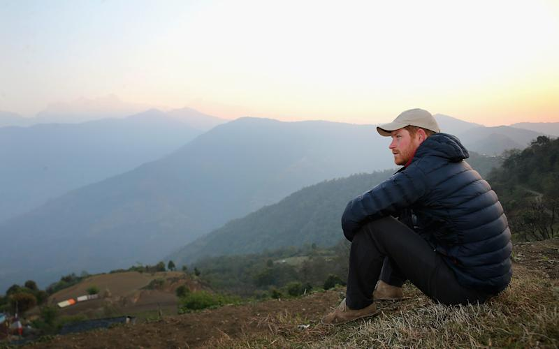Prince Harry watches the sun rise after spending the night in the Himalayan hilltop village of Leorani on his visit to Nepal in March 2016 - 2016 Getty Images