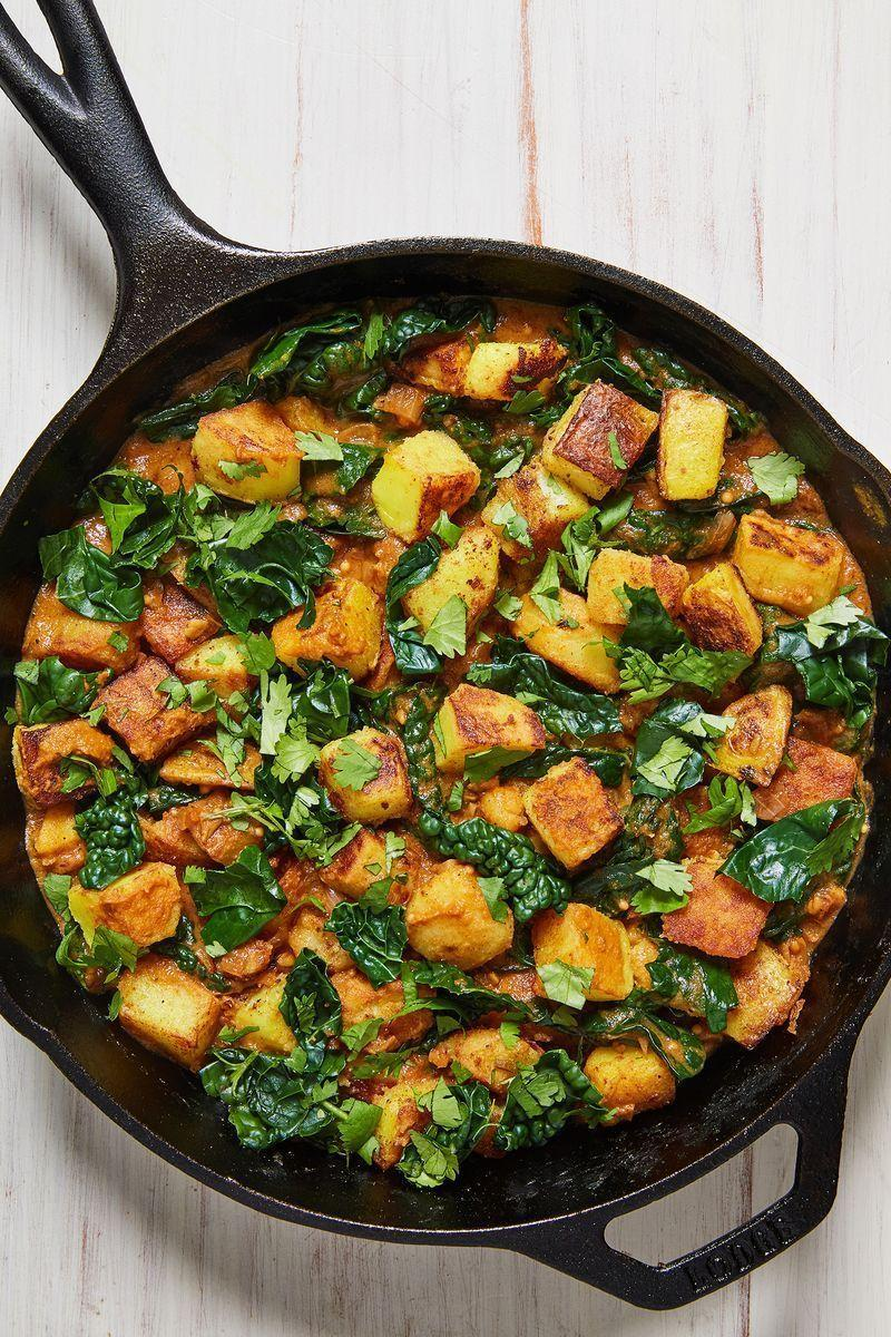 """<p>This Sag Aloo recipe is one of my favourite <a href=""""https://www.delish.com/uk/cooking/recipes/g28795355/healthy-potato-side-dishes/"""" rel=""""nofollow noopener"""" target=""""_blank"""" data-ylk=""""slk:potato side dish"""" class=""""link rapid-noclick-resp"""">potato side dish</a> ideas. And I personally think no <a href=""""https://www.delish.com/uk/curry-recipes"""" rel=""""nofollow noopener"""" target=""""_blank"""" data-ylk=""""slk:curry"""" class=""""link rapid-noclick-resp"""">curry</a> feast is complete without a side bowl of this carb-loaded goodness. I've swapped in spinach for <a href=""""https://www.delish.com/uk/cooking/recipes/g30700699/kale-recipes/"""" rel=""""nofollow noopener"""" target=""""_blank"""" data-ylk=""""slk:kale"""" class=""""link rapid-noclick-resp"""">kale</a>, so it's not strictly traditional, but if you're not fancying that then just add <a href=""""https://www.delish.com/uk/cooking/a29469948/how-to-cook-spinach/"""" rel=""""nofollow noopener"""" target=""""_blank"""" data-ylk=""""slk:spinach"""" class=""""link rapid-noclick-resp"""">spinach</a> instead - simple! </p><p>Get the <a href=""""https://www.delish.com/uk/cooking/recipes/a31951261/sag-aloo/"""" rel=""""nofollow noopener"""" target=""""_blank"""" data-ylk=""""slk:Sag Aloo"""" class=""""link rapid-noclick-resp"""">Sag Aloo</a> recipe.</p>"""