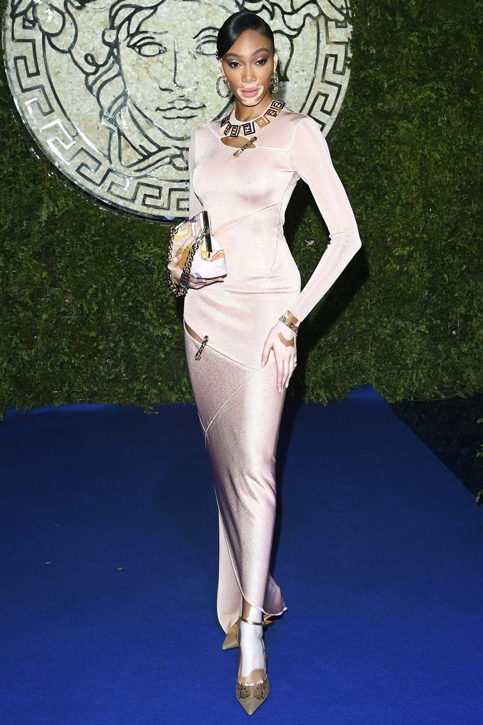 <p><strong>26 September</strong></p><p>Model Winnie Harlow in a floor-length baby pink gown at the Fendi x Versace event. </p>