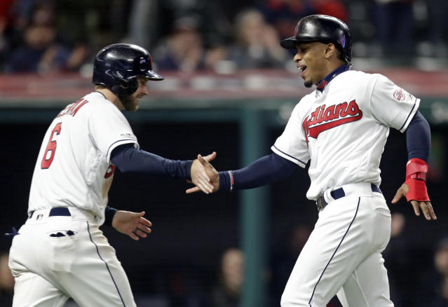 Cleveland Indians' Francisco Lindor, right, celebrates with Cleveland Indians' Mike Freeman after both score on a single by Jose Ramirez in the second inning during the second game of a baseball doubleheader against the Atlanta Braves, Saturday, April 20, 2019, in Cleveland. (AP Photo/Tony Dejak)