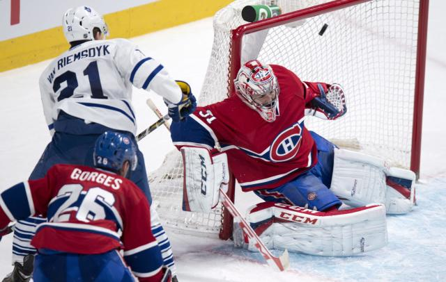 Toronto Maple Leafs' James van Riemsdyk scores past Montreal Canadiens goalie Carey Price as defenseman Josh Gorges looks on during the second period of an NHL hockey game Saturday, Nov. 30, 2013 in Montreal. (AP Photo/The Canadian Press, Paul Chiasson)