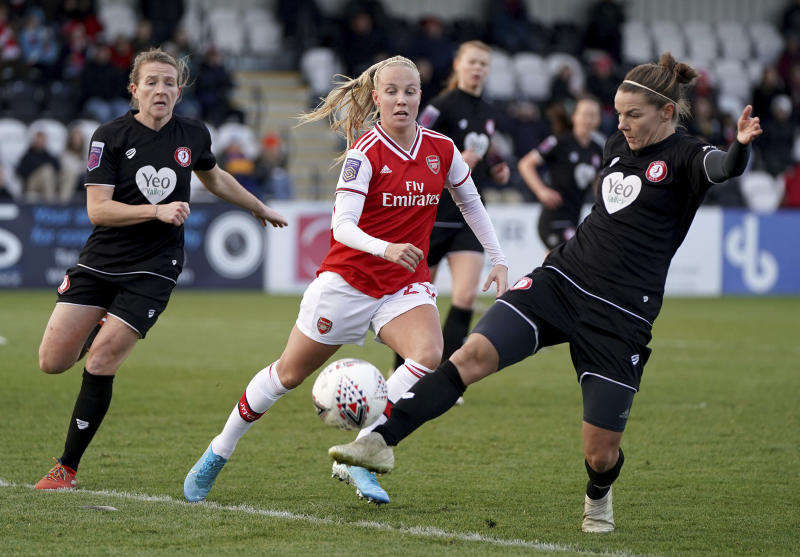 Arsenal's Beth Mead and Bristol City's Loren Dykes, right, battle for the ball during the FA Women's Super League match against Bristol City at Meadow Park, Borehamwood, England, Sunday Dec. 1, 2019. (Tess Derry/PA via AP)