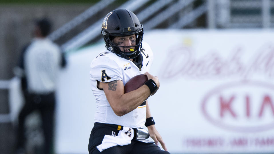 Appalachian State Mountaineers quarterback Zac Thomas (12) runs the ball during an NCAA football game against the Marshall Thundering Herd on Saturday, Sept. 19, 2020 in Huntington, W.VA. (AP Photo/Emilee Chinn)