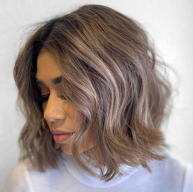 """<p>The best thing about ash-brown hair? It<strong> looks great on any length</strong>, as evidenced by this cute <a href=""""https://www.cosmopolitan.com/style-beauty/beauty/g28245197/short-bob-haircut-ideas/"""" rel=""""nofollow noopener"""" target=""""_blank"""" data-ylk=""""slk:bob haircut"""" class=""""link rapid-noclick-resp"""">bob haircut</a>. I love how this style has a touch of blonde in it too.</p><p><a href=""""https://www.instagram.com/p/B8-XG3cBgpK/"""" rel=""""nofollow noopener"""" target=""""_blank"""" data-ylk=""""slk:See the original post on Instagram"""" class=""""link rapid-noclick-resp"""">See the original post on Instagram</a></p>"""